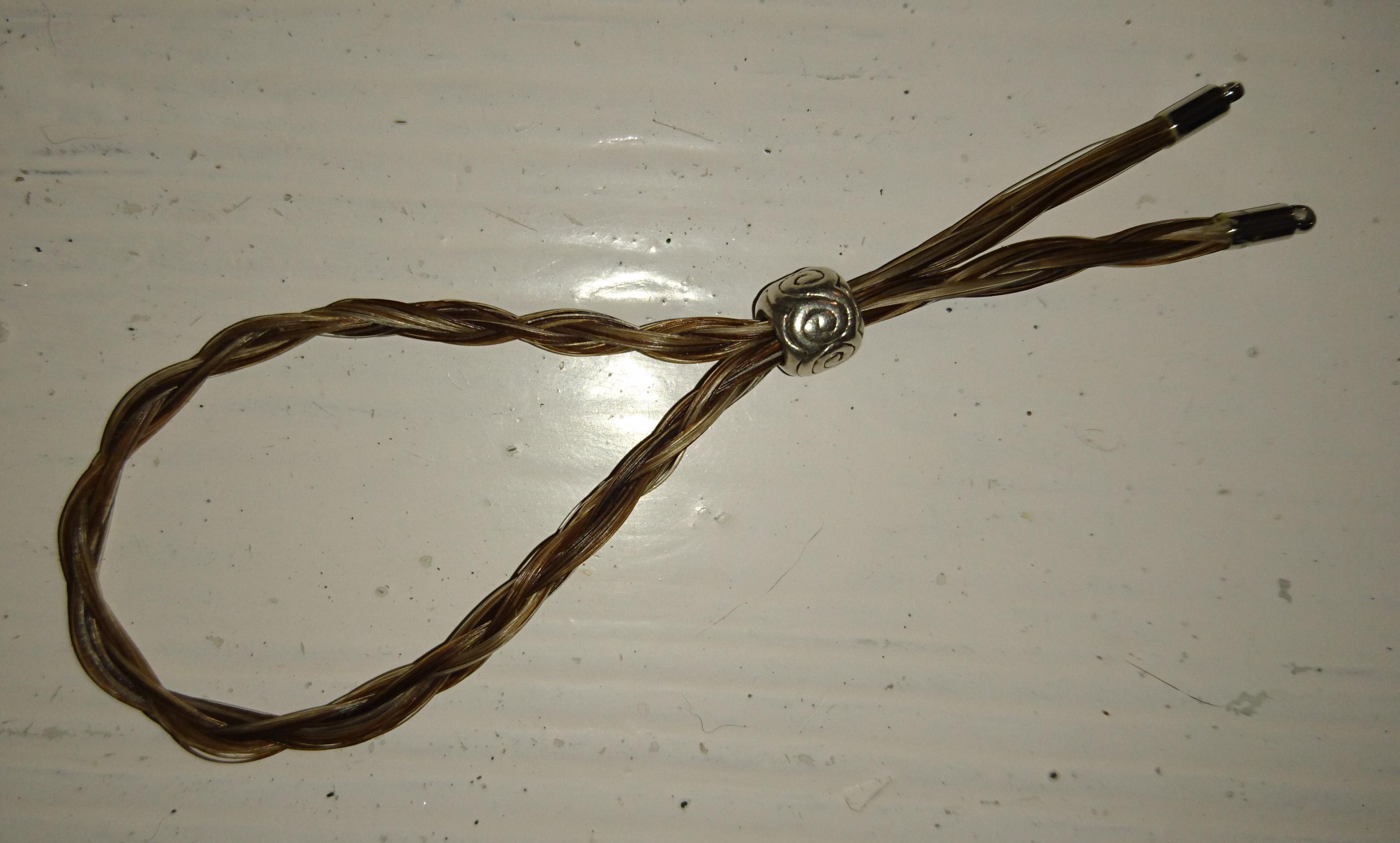 Smal rond gevlochten armbandje van Ilion